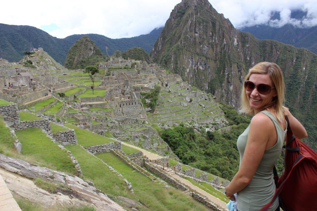 Girl smiling overlooking Machu Picchu, Peru