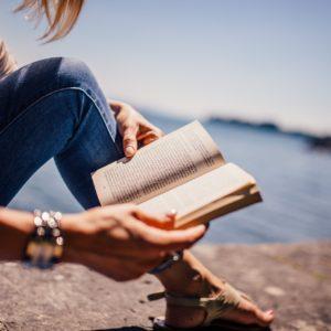 Flo Jacquette reading a book