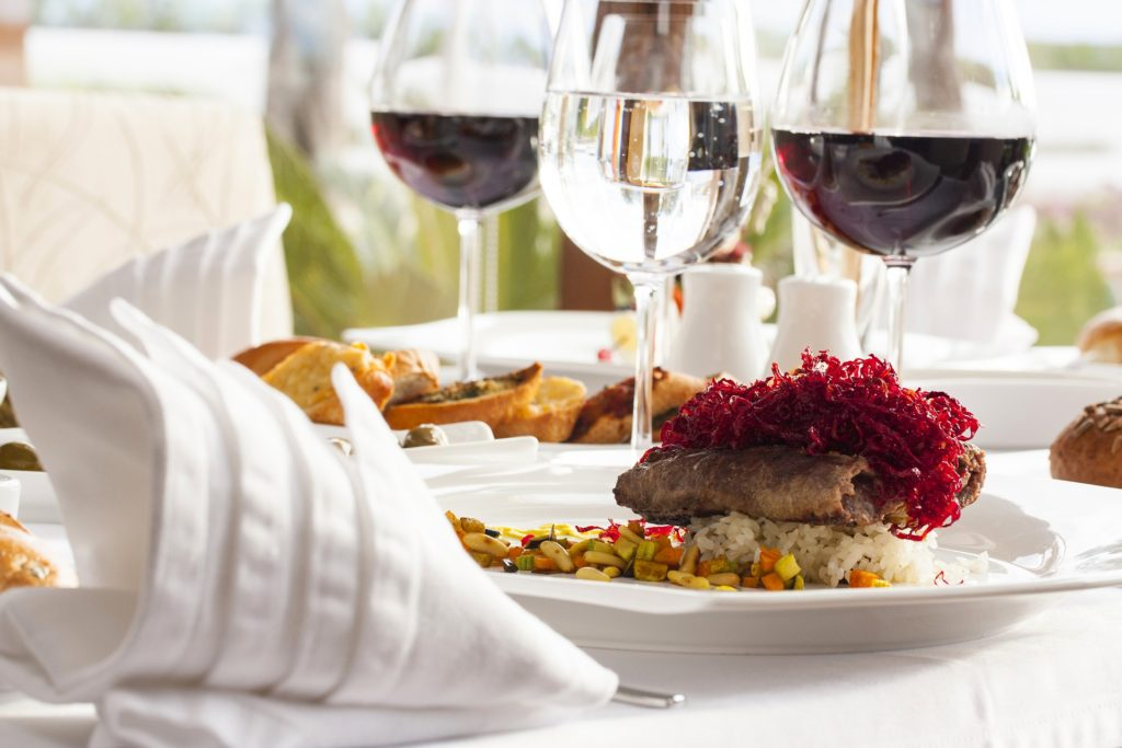 Plate of fine cuisine with matching wines