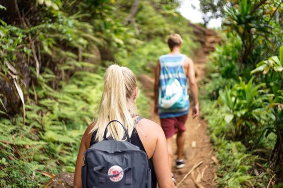 Man and woman walking away up a path