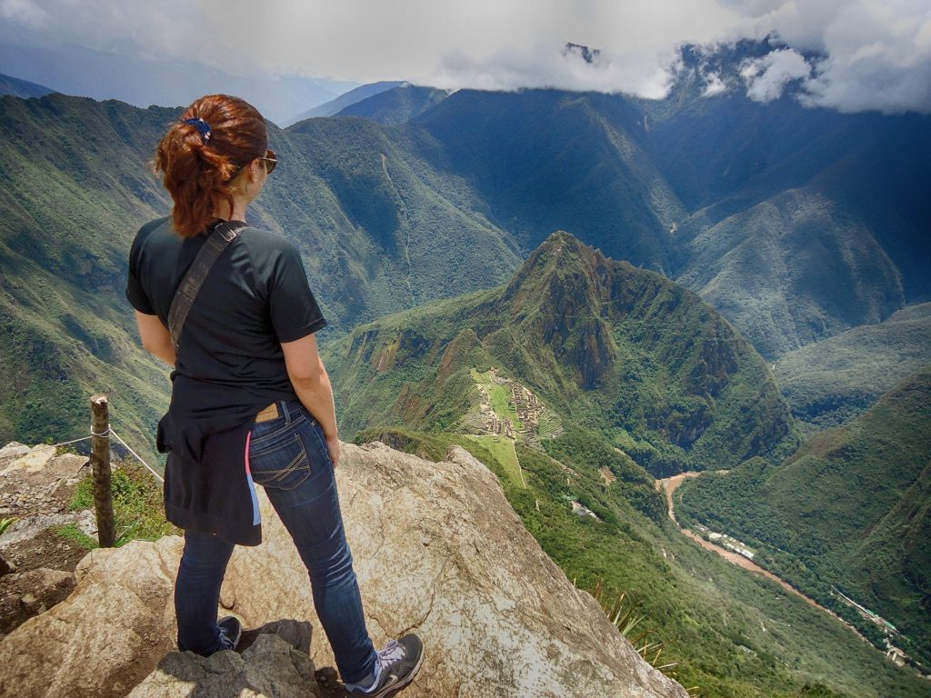 Woman standing overlooking Machu Picchu, in Peru