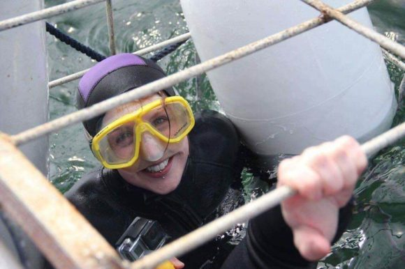 Young lady smiling while cage diving