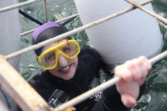 Happy girl in a shark cage